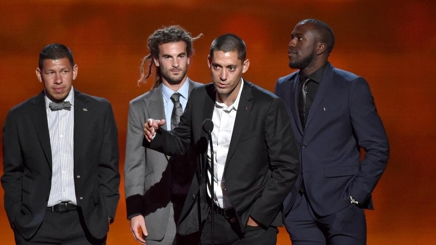 Team captain Clint Dempsey, center, and fellow members of the U.S. men's soccer team accept the award for best moment, at the ESPY Awards at the Nokia Theatre on Wednesday, July 16, 2014, in Los Angeles. (Photo by John Shearer/Invision/AP)