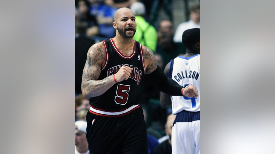 FILE - In this March 30, 2013 file photo, Chicago Bulls power forward Carlos Boozer (5) heads down court after a shot in an NBA basketball game in Dallas. The Chicago Bulls have used the amnesty clause to cut forward Carlos Boozer after four seasons with the team, Tuesday, July 15, 2014.  (AP Photo/Michael Mulvey, File)