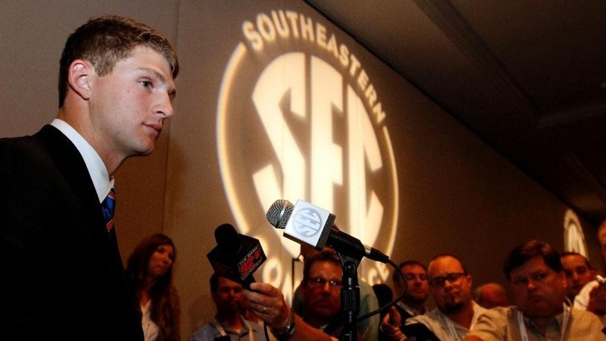 Florida quarterback Jeff Driskel speaks to media at SEC media days on Monday, July 14, 2014, in Hoover, Ala. (AP Photo/Butch Dill)