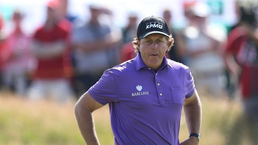 Phil Mickelson of the US prepares to putt on the 9th green during the first day of the British Open Golf championship at the Royal Liverpool golf club, Hoylake, England, Thursday July 17, 2014. (AP Photo/Scott Heppell)