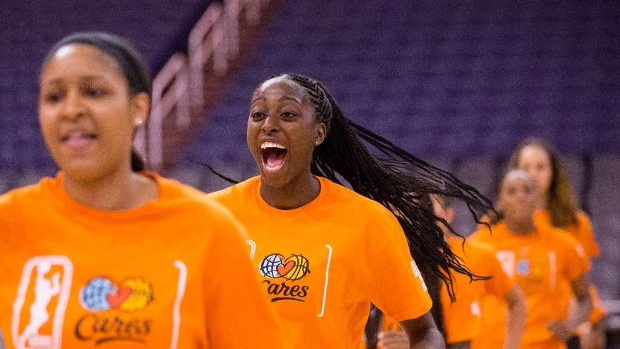 WNBA All-Stars Chiney Ogwumike, of the Connecticut Sun, has fun during a basketball clinic with children from Phoenix area Boys and Girls Clubs at U.S. Airways Center in Phoenix, Friday, July 18, 2014. The WNBA All-Star game couldn't be held in a more appropriate place this season than in Phoenix, where the Mercury are 17-3 and riding an 11-game winning streak. (AP Photo/The Arizona Republic, Cheryl Evans)  MARICOPA COUNTY OUT; MAGS OUT; NO SALES