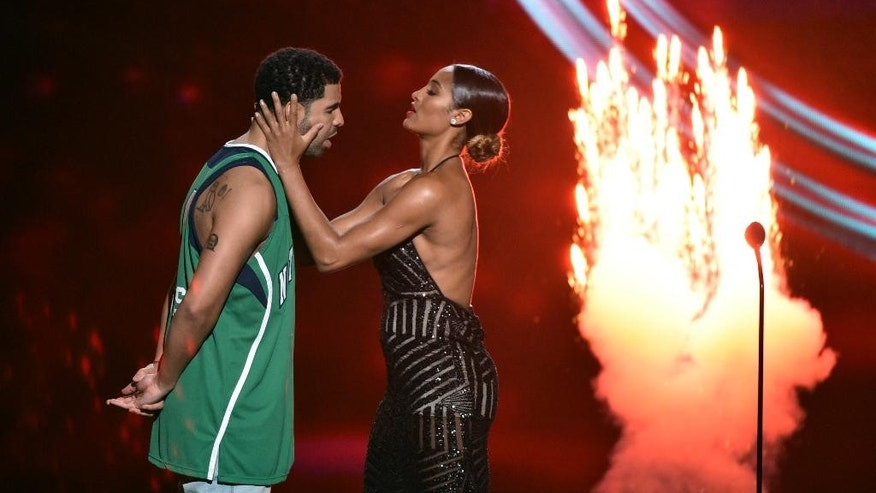 Skylar Diggins and Drake, left, stand on stage at the ESPY Awards at the Nokia Theatre on Wednesday, July 16, 2014, in Los Angeles. (Photo by John Shearer/Invision/AP)