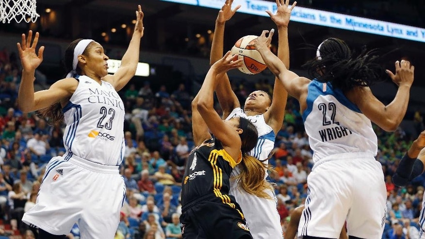 Minnesota Lynx guard Monica Wright (22) blocks the shot of Tulsa Shock guard Skylar Diggins (4) in the second half of a WNBA basketball game, Wednesday, July 16, 2014, in Minneapolis. The Lynx won 93-82. (AP Photo/Stacy Bengs)