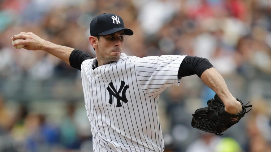 New York Yankees starting pitcher Brandon McCarthy throw during the first inning of a baseball game against the Cincinnati Reds, Saturday, July 19, 2014, at Yankee Stadium in New York. (AP Photo/Julio Cortez)