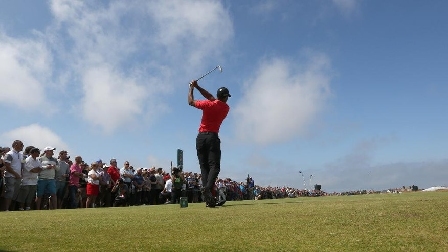 Tiger Woods of the US plays a shot off the 17th tee during the final round of the British Open Golf championship at the Royal Liverpool golf club, Hoylake, England, Sunday July 20, 2014. (AP Photo/Jon Super)