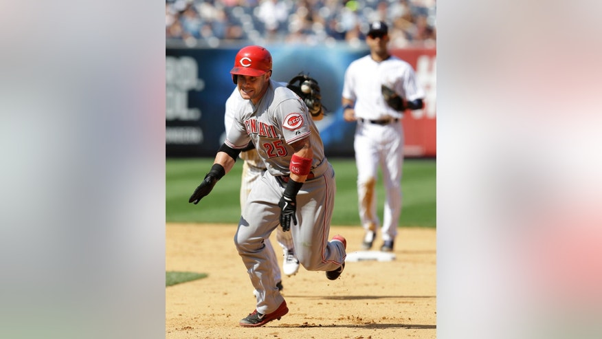 Cincinnati Reds' Skip Schumaker reacts while caught in a run-down during the eighth inning of the game against the New York Yankees at Yankee Stadium Sunday, July 20, 2014 in New York. (AP Photo/Seth Wenig)