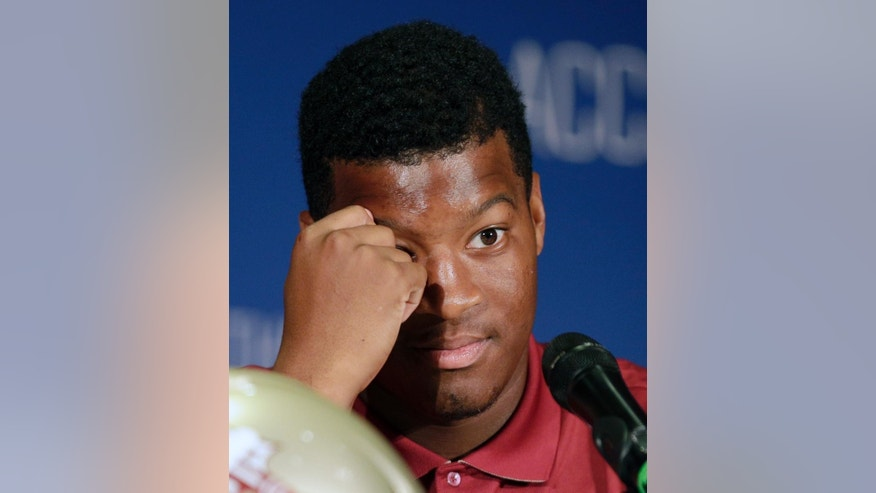Florida State's Jameis Winston answers a question during a news conference at the Atlantic Coast Conference Football kickoff in Greensboro, N.C., Sunday, July 20, 2014. (AP Photo/Chuck Burton)