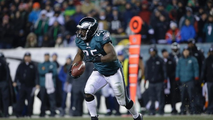 File-This Jan. 4, 2014, file photo shows Philadelphia Eagles' LeSean McCoy running during the second half of an NFL wild-card playoff football game against the New Orleans Saints in Philadelphia. (AP Photo/Matt Rourke, File)