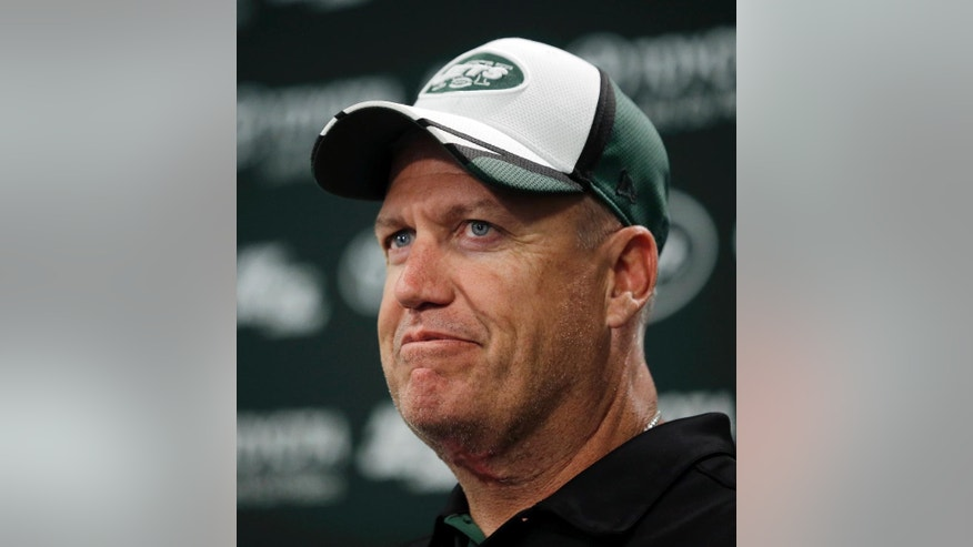 File-This June 17, 2014, file photo shows New York Jets head coach Rex Ryan listening to a question during a news conference after a workout at NFL football mini camp in Florham Park, N.J. Ryan was on the hot seat for most of his fifth season with the Jets, and his fate wasn't known until owner Woody Johnson and general manager John Idzik announced after the season finale in Miami that the coach would be back. Ryan was rewarded with a multiyear extension that could keep him in New York through at least 2016 season. There's no guarantee, though, that he'll last beyond this season if the Jets don't at least make a playoff run. (AP Photo/Mel Evans, File)