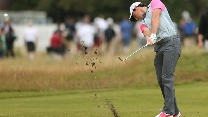 July 20, 2014: Rory McIlroy of Northern Ireland plays from the 1st fairway during the final round of the British Open Golf championship at the Royal Liverpool golf club, Hoylake, England. (AP)