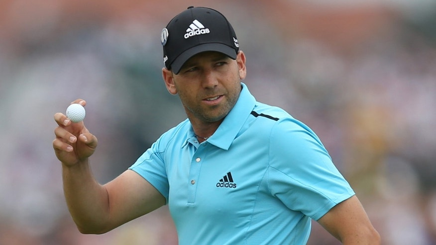 Sergio Garcia of Spain holds up his ball after playing a birdie on the 1st green during the final round of the British Open Golf championship at the Royal Liverpool golf club, Hoylake, England, Sunday July 20, 2014. (AP Photo/Scott Heppell)