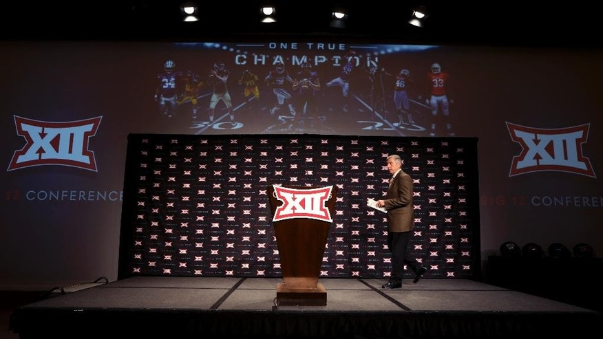 Big 12 commissioner Bob Bowlsby takes the stage to speak at the opening of the NCAA college Big 12 Conference football media days in  Dallas, Monday, July 21, 2014. (AP Photo/LM Otero)