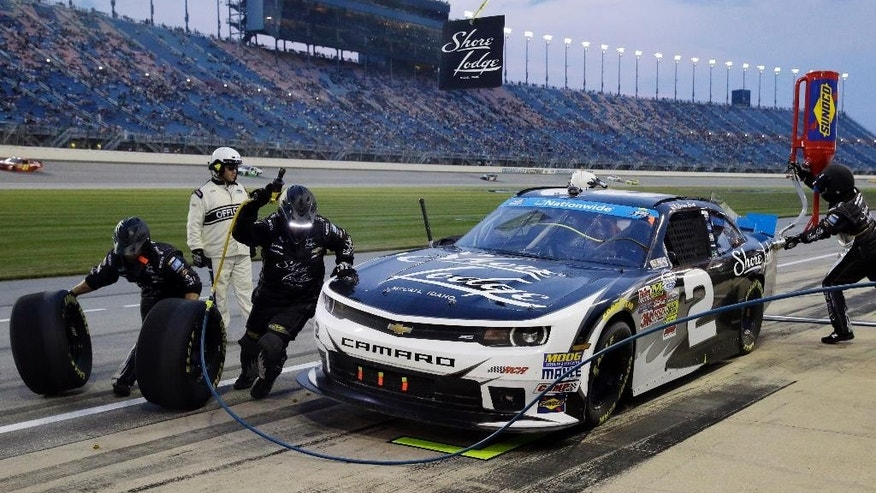 Brian Scott makes a pit stop during the NASCAR Nationwide series auto race at Chicagoland Speedway in Joliet, Ill., Saturday, July 19, 2014. (AP Photo/Nam Y. Huh)
