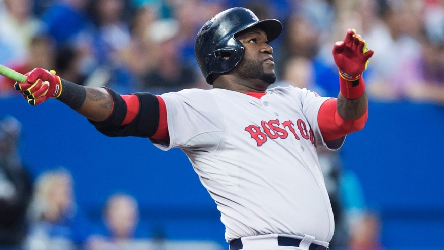 Boston Red Sox's David Ortiz hits his second two-run home run of the game during the fifth inning of a baseball game against the Toronto Blue Jays in Toronto on Monday, July 21, 2014. (AP Photo/The Canadian Press, Darren Calabrese)