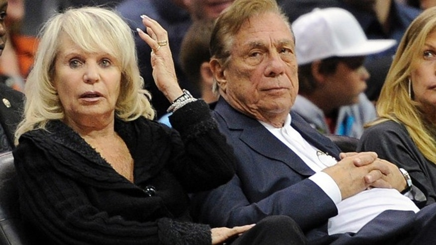 Nov. 12, 2010: Shelly Sterling sits with her husband, Donald Sterling, right, during the Los Angeles Clippers' NBA basketball game against the Detroit Pistons in Los Angeles.