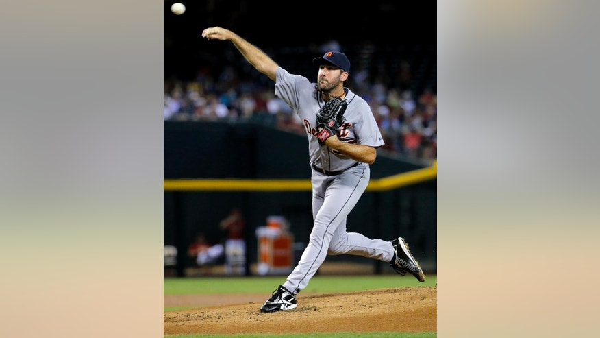 Detroit Tigers pitcher Justin Verlander throws against the Arizona Diamondbacks during the first inning of a baseball game, Monday, July 21, 2014, in Phoenix.  (AP Photo/Matt York)