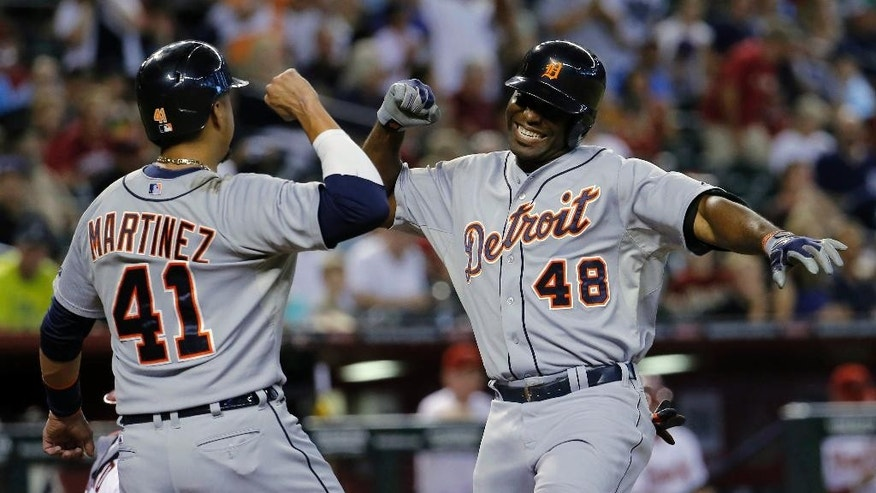Detroit Tigers' Torii Hunter (48) celebrate his two run home run against the Arizona Diamondbacks with teammate Victor Martinez (41) during the first inning of a baseball game, Monday, July 21, 2014, in Phoenix.  (AP Photo/Matt York)