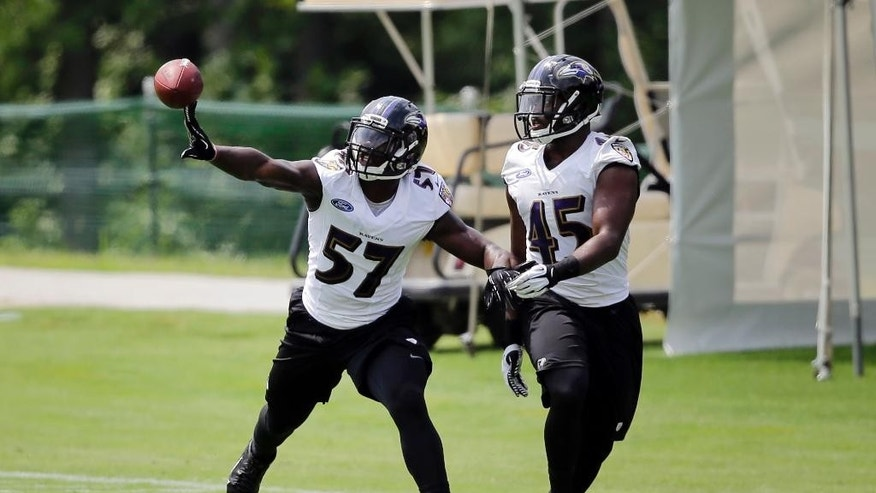 Baltimore Ravens linebacker C.J. Mosley, left, breaks up a pass attempt to teammate Zachary Orr during a drill at NFL football practice, Tuesday, July 22, 2014, at the team's practice facility in Owings Mills, Md. (AP Photo)
