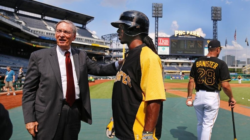 Baseball Commissioner Bud Selig, left, chats with Pittsburgh Pirates center fielder Andrew McCutchen, center, during batting practice at PNC Park before a baseball game between the Pirates and the Los Angeles Dodgers, Tuesday, July 22, 2014, in Pittsburgh. (AP Photo)
