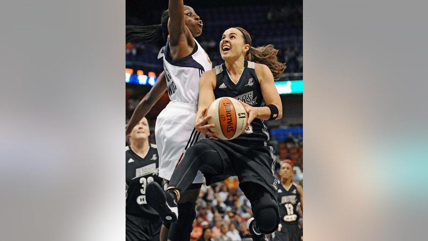 FILE - In this July 1, 2014 file photo, San Antonio Stars' Becky Hammon, right, drives to the basket as Connecticut Sun's Chiney Ogwumike, left, defends during the second half of a WNBA basketball game in Uncasville, Conn. The Stars 16-year WNBA veteran Becky Hammon will retire at the conclusion of the 2014 WNBA season, the team announced Wednesday, July 23, 2014. Hammon will end her career as the Stars all-time leader in assists, points per game and three-point field goals made.(AP Photo/Jessica Hill, File)