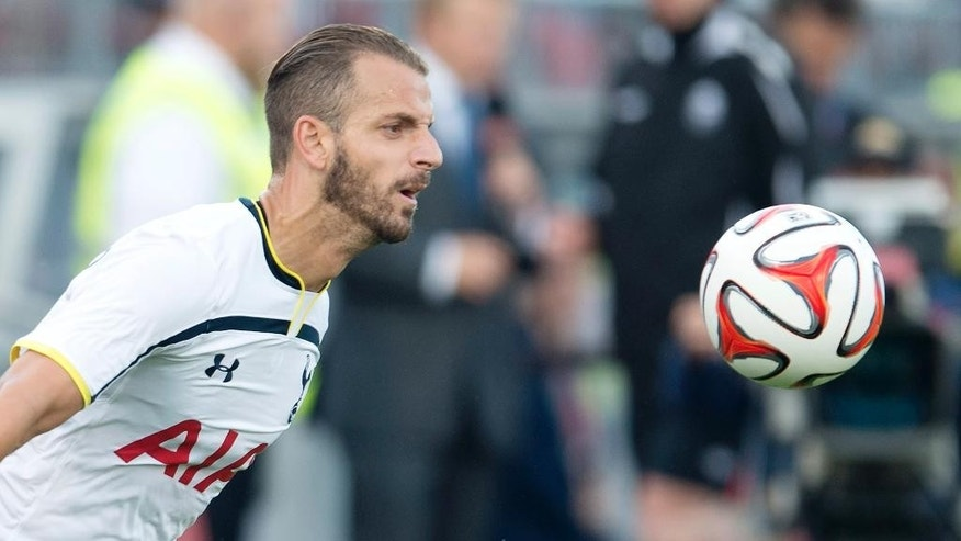 Tottenham Hotspur's Roberto Soldado controls the ball during the first half of a friendly soccer match against Toronto FC in Toronto on Wednesday, July 23, 2014. (AP Photo/The Canadian Press, Darren Calabrese)