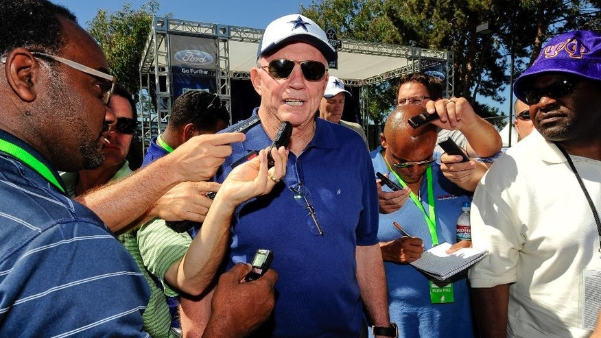 "Dallas Cowboys owner Jerry Jones, center, talks with members of the media at the conclusion of the ""State of the team"" news conference during NFL football training camp on Wednesday, July 23, 2014, in Oxnard, Calif. (AP Photo/Gus Ruelas)"