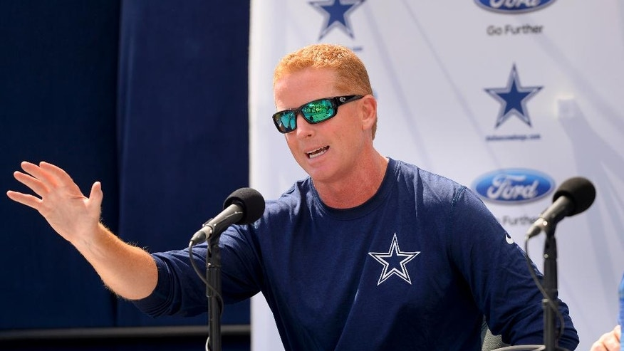 "Dallas Cowboys head coach Jason Garrett speaks at the ""State of the team"" news conference during NFL football training camp on Wednesday, July 23, 2014, in Oxnard, Calif. (AP Photo/Gus Ruelas)"