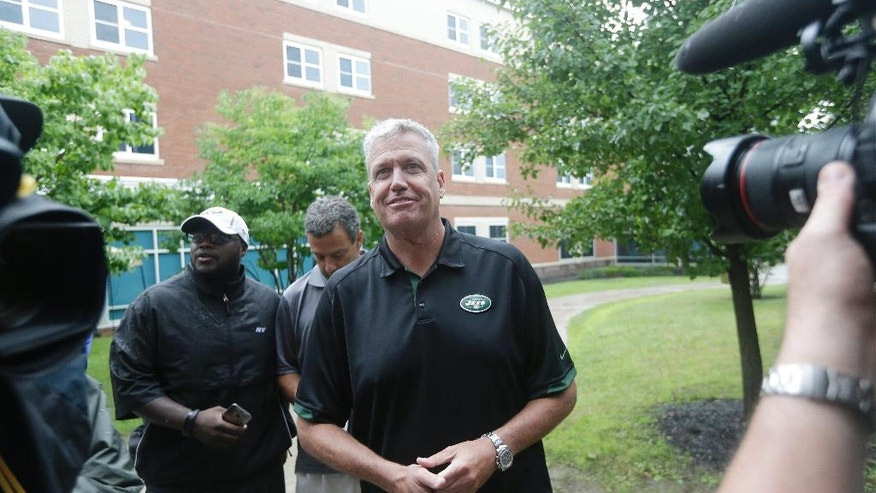 New York Jets head coach Rex Ryan arrives to respond to questions for a news interview before a NFL football training camp,  Wednesday, July 23, 2014, in Cortland, N.Y. (AP Photo/Frank Franklin II)