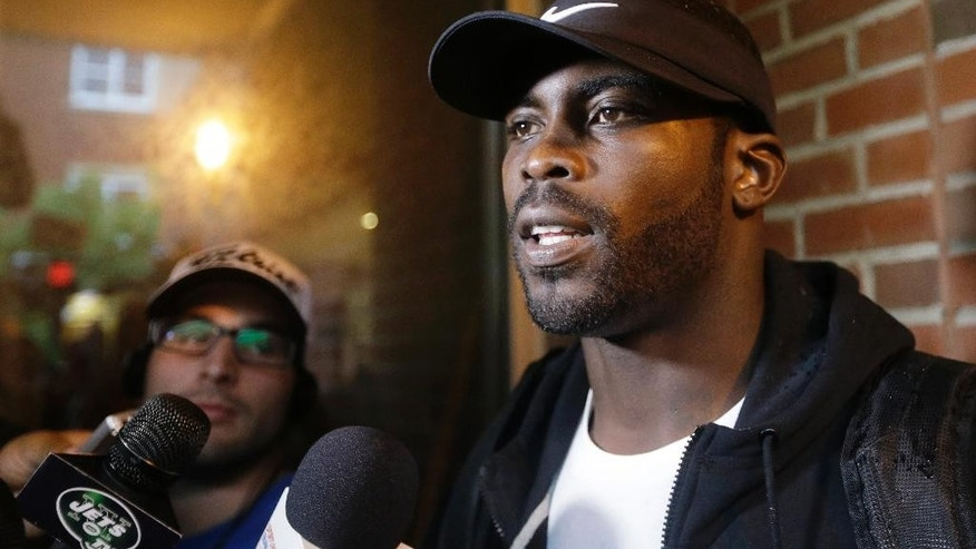 New York Jets' Michael Vick responds to questions during a news interview before the of a NFL football training camp,  Wednesday, July 23, 2014, in Cortland, N.Y. (AP Photo/Frank Franklin II)
