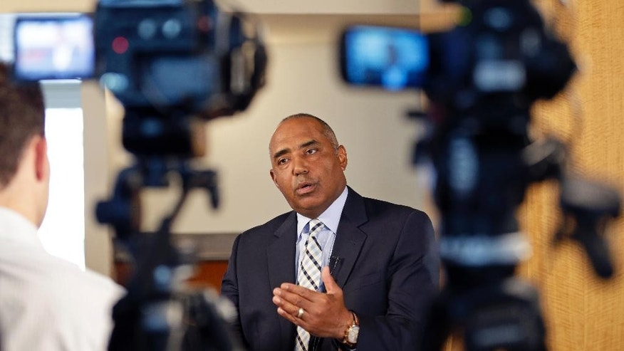 Cincinnati Bengals head coach Marvin Lewis is interviewed during the team's pre training camp luncheon, Tuesday, July 22, 2014, in Cincinnati. The NFL football team has their first practice at training camp this Thursday. (AP Photo)