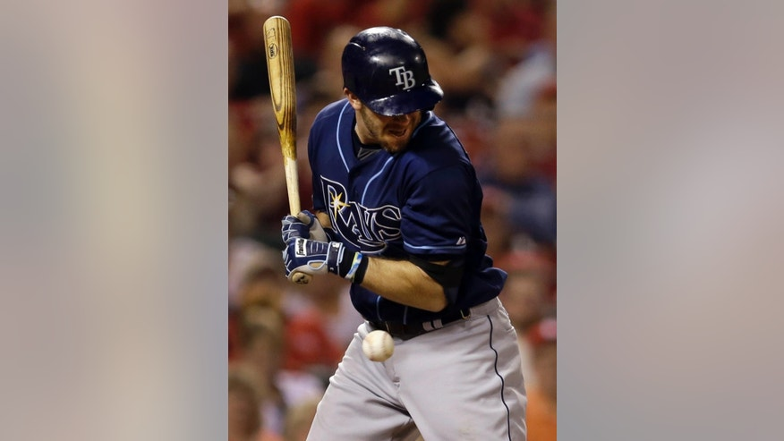 Tampa Bay Rays' Evan Longoria is hit by a pitch during the fifth inning of a baseball game against the St. Louis Cardinals Tuesday, July 22, 2014, in St. Louis. (AP Photo/Jeff Roberson)