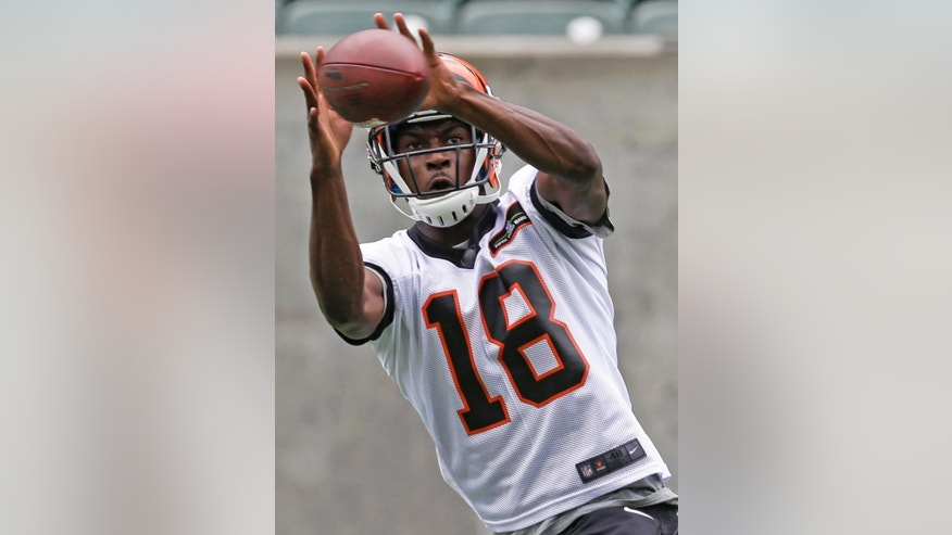 FILE - In this  June 11, 2014, file photo, Cincinnati Bengals wide receiver A.J. Green catches a pass during an NFL football mandatory minicamp in Cincinnati. Cincinnati opens training camp Thursday afternoon, July 24. (AP Photo/File)
