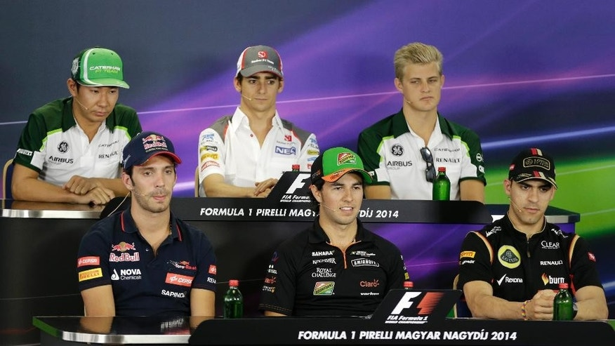 (front row left to right) Scuderia Toro Rosso driver Jean-Eric Vergne of France, Force India driver Sergio Perez of Mexico, Lotus driver Pastor Maldonado of Venezuela, (back row left to right) Caterham driver Kamui Kobayashi of Japan, Sauber driver Esteban Gutierrez  of Mexico, Caterham driver Marcus Ericsson of Sweden, attend a press conference at the Hungarian Formula One Grand Prix in Budapest, Hungary, Thursday, July 24, 2014. The Hungarian Grand Prix will be held on Sunday, July 27, 2014. (AP Photo/Petr David Josek)