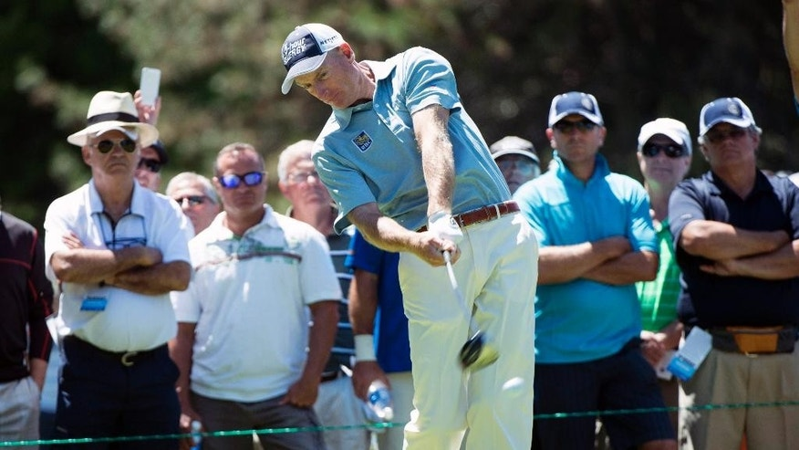 Jim Furyk, of the United States, hits off the second tee during first-round play at the Canadian Open golf championship on Thursday, July 24, 2014, in Montreal. (AP Photo/The Canadian Press, Paul Chiasson)