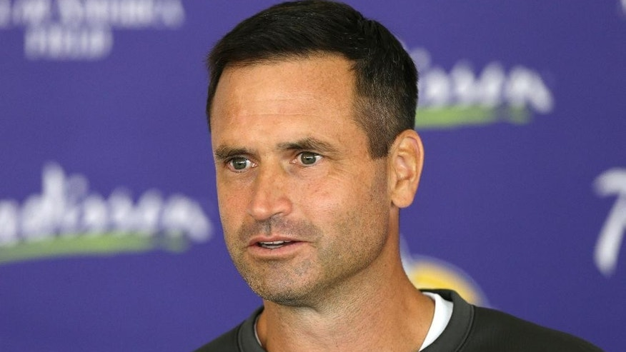FILE - In this July 27, 2013 file photo, Minnesota Vikings special teams coordinator Mike Priefer speaks to reporters following practice at NFL football training camp in Mankato, Minn. Once again, the Vikings are reporting to training camp with some sort of swirling controversy or off-the-field distraction to address. This time, it's the lawsuit brought by former punter Chris Kluwe over alleged discrimination, following a six-month investigation that resulted in a three-game suspension of Priefer for an anti-gay remark.  (AP Photo/Charlie Neibergall, File)
