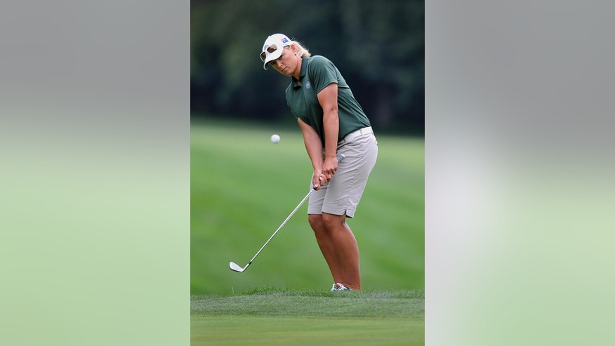 Katherine Kirk, of Australia, chips onto the green on the second hole during the first round of the International Crown LPGA golf tournament Thursday, July 24, 2014, in Baltimore.(AP Photo/Gail Burton)