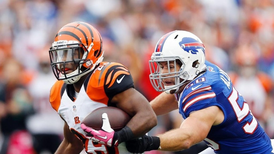 ADVANCE FOR WEEKEND OF JULY 26 & 27 - FILE - In this Oct. 13, 2013, file photo, Cincinnati Bengals' Giovani Bernard (25) runs downfield as Buffalo Bills' Kiko Alonso closes in during the second half of an NFL football game in Orchard Park, N.Y. Three playmaking linebackers did not even make it through the offseason healthy: Alonso, Dallas' Sean Lee and Atlanta's Sean Weatherspoon, all hurt in seemingly tame circumstances. (AP Photo/Gary Wiepert File)