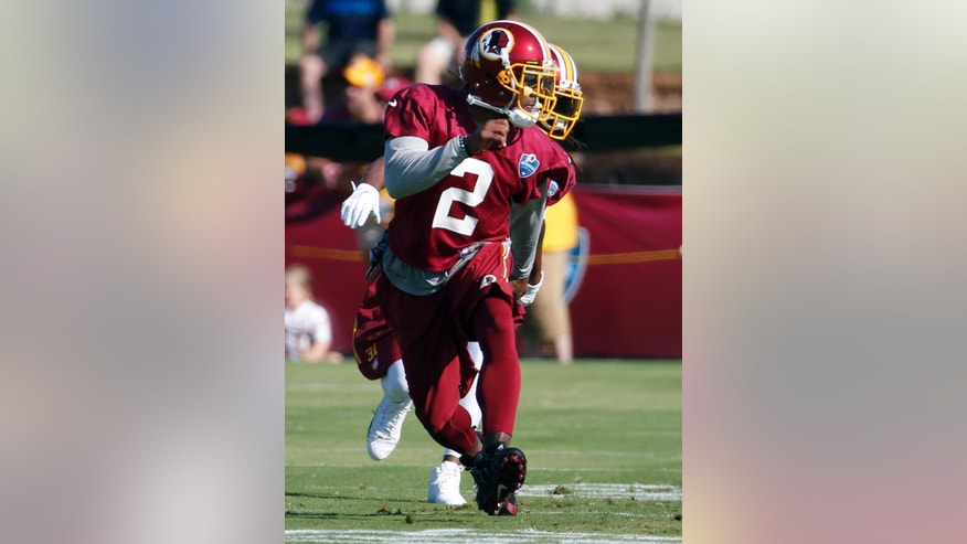 Washington Redskins cornerback DeAngelo Hall runs in a drill during practice at the team's NFL football training facility, Friday, July 25, 2014 in Richmond, Va. (AP Photo)