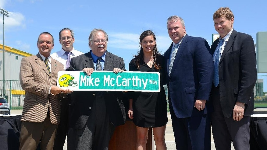 From left, Green Bay Mayor Jim Schmitt, Brown County Executive Troy Streckenbach, Ashwaubenon Village President Mike Aubinger, Alex McCarthy, Green Bay Packers head coach mike McCarthy and Packers president Mark Murphy pose for a photo during a ceremony to officially dedicate a street in McCarthy's name Wednesday, July 23, 2014 in Ashwaubenon, Wis. (AP Photo/The Green Bay Press-Gazette,  Jim Matthews) NO SALES