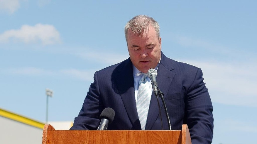 Green Bay Packers head coach Mike McCarthy gets emotional as he speaks during a ceremony to officially dedicate a street in his name Wednesday, July 23, 2014 in Ashwaubenon, Wis. (AP Photo/The Green Bay Press-Gazette,  Jim Matthews) NO SALES