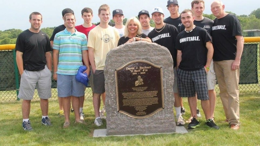 Rhonda Bachner stands with former teammates of her son behind a bronze plaque memorializing David Jordan Bachner near the bullpen at New Jersey's West Windsor-Plainsboro North High. (Courtesy: Rhonda Bachner)