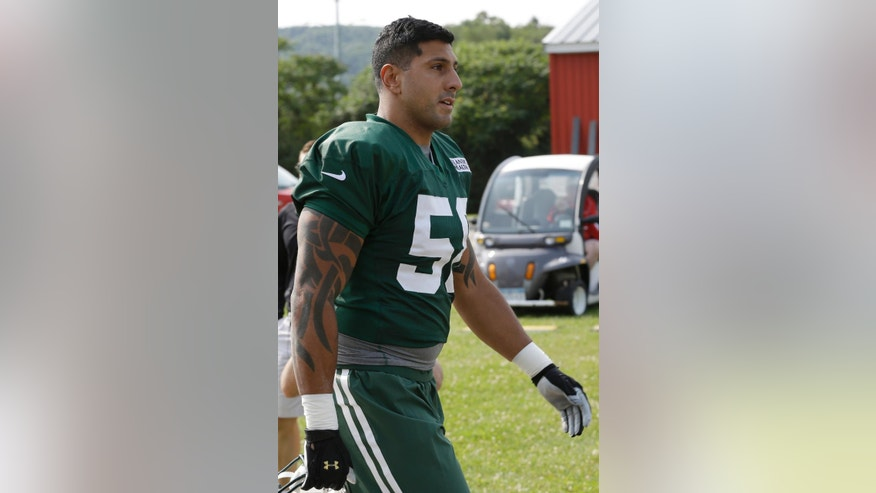 New York Jets' Jason Babin walks to practice during their NFL football training camp Friday, July 25, 2014, in Cortland, N.Y.  (AP Photo)