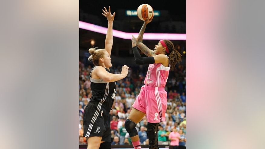Minnesota Lynx guard Seimone Augustus (33) shoots the ball against San Antonio Stars center Jayne Appel during the first half of a WNBA basketball game, Friday, July 25, 2014, in Minneapolis. (AP Photo/Stacy Bengs)