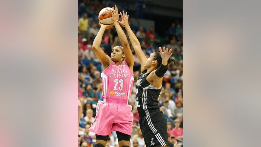 Minnesota Lynx forward Maya Moore (23) goes up for a basket against San Antonio Stars guard Kayla McBride during the first half of a WNBA basketball game, Friday, July 25, 2014, in Minneapolis. (AP Photo/Stacy Bengs)
