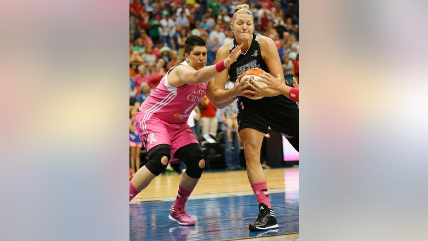 Minnesota Lynx center Janel McCarville, left, vies for a rebound ball with San Antonio Stars center Jayne Appel during the first half of a WNBA basketball game, Friday, July 25, 2014, in Minneapolis. (AP Photo/Stacy Bengs)