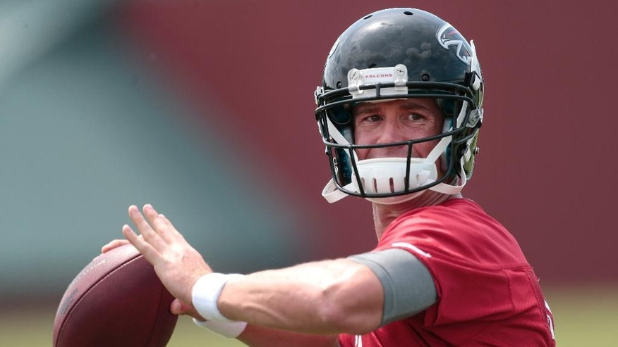 Atlanta Falcons quarterback Matt Ryan (2) throws during NFL football training camp Friday, July 25, 2014, in Flowery Branch, Ga. (AP Photo)