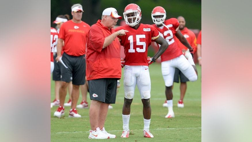 Kansas City Chiefs head coach Andy Reid, left, talks to wide receiver A.J. Jenkins (15) during an NFL football training camp Saturday, July 26, 2014, in St. Joseph, Mo. (AP Photo/The St. Joseph News-Press, Sait Serkan Gurbuz)