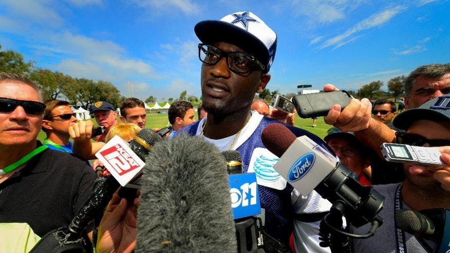 Dallas Cowboys linebacker Rolando McClain talks with the press at the end of morning practice after his first day of practice since his retirement during an NFL training camp, Saturday, July 26, 2014, in Oxnard, Calif. (AP Photo/Gus Ruelas)