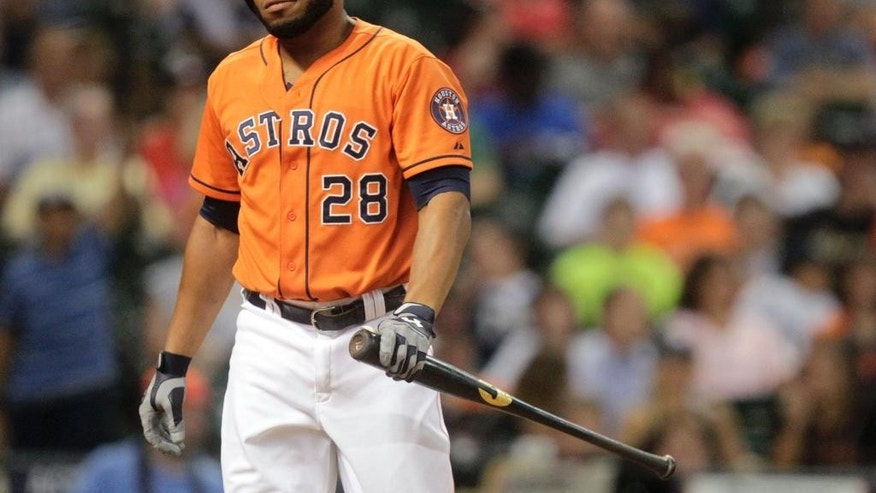 Houston Astros' Jon Singleton walks back to the dugout after striking out to end the eighth inning stranding teammate Jason Castro at second during a baseball game against the Miami Marlins, Friday, July 25, 2014, in Houston. (AP Photo/Patric Schneider)
