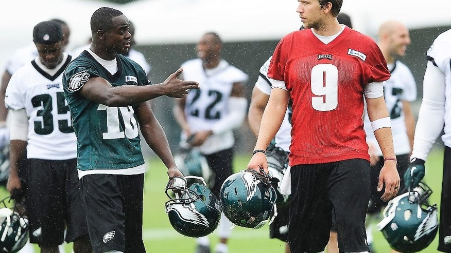 Philadelphia Eagles' Nick Foles (9) walks off the field with Jeremy Maclin at the end of NFL football training camp on Saturday, July 26, 2014, in Philadelphia. (AP Photo/Michael Perez)
